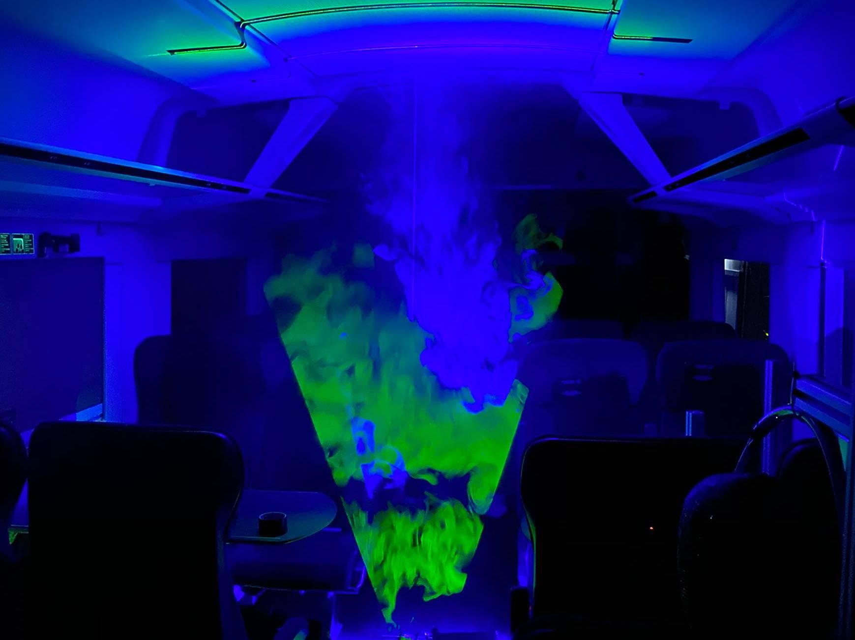 Laser-Rauch-Visualisierungen in einem Zug